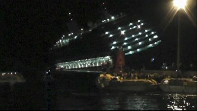 The capsized Costa Concordia cruise ship is seen from a rescue vessel near Giglio, Italy, January 13, 2012 in this still image taken from an amateur video shot by a German passenger and obtained January 14, 2012. REUTERS/Amateur Video via Reuters TV