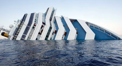 Costa Concordia cruise ship that ran aground is seen off the west coast of Italy at Giglio island January 14, 2012. REUTERS/ Remo Casilli