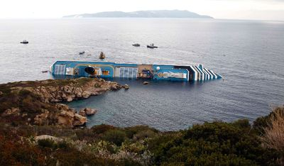 A view shows the Costa Concordia cruise ship that ran aground off the west coast of Italy, at Giglio island January 15, 2012. (REUTERS/ Max Rossi)