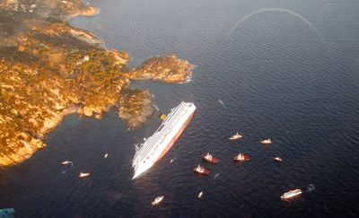 Costa Concordia cruise ship that ran aground is seen off the west coast of Italy at Giglio island January 14, 2012. REUTERS/Italian Guardia di Finanza