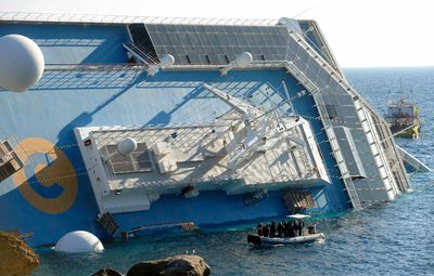 A cruise ship that ran aground is seen off the west coast of Italy at Giglio island January 14, 2012. REUTERS