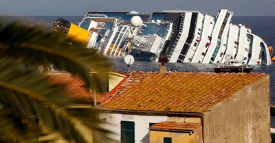 A view of the Costa Concordia cruise ship that ran aground off the west coast of Italy, at Giglio island, January 18, 2012. REUTERS/Max Rossi