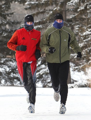 (left to right) Brothers' Paul Klann and Gerhardt Klann jog through Capilano Park and into Gold Bar Park, in Edmonton Alberta, Tuesday 17, 2012. the two said that it would have to get to -30C or -35C (with no wind chill) before they would consider canceling their run. DAVID BLOOM EDMONTON SUN  QMI AGENCY