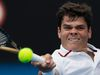 Milos Raonic hits a return to Philipp Petzschner during their second-round match at the Australian Open in Melbourne, Australia, Jan. 19, 2012. (DARREN WHITESIDE/Reuters)