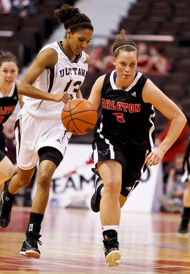 Carleton Ravens Alyson Bush drives up court after stealing the ball from Ottawa Gee-Gee Tatiana Hanlan during play at the MBNA Capital Hoops Classic at Scotibank Place. Wednesday January 18,2012. (ERROL MCGIHON/THE OTTAWA SUN/QMI AGENCY).