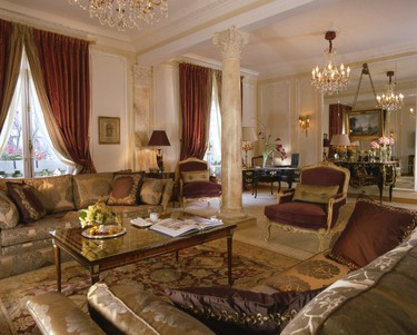 """Hotel Plaza Athenee, Paris: Staying at the royal suite at the Hotel Plaza Athenee is like """"owning a corner of Paris,"""" the hotel says. The suite is stacked with the newest technology from NeoPDP plasma TV to 3D Full HD glasses with a Panasonic 3D Full HD System, but it still has the elegance and comfort of Paris with four bedrooms, antique furniture, luxury brand fabrics and silks, bathrooms covered in marble mosaics and a view of the famous Avenue Montaigne and a side view of the Eiffel Tower. The two master bedrooms have their own private dressing rooms and the double living room features a bookcase, while the dining room can seat 12 people. (Courtesy Dorchester Collection)"""
