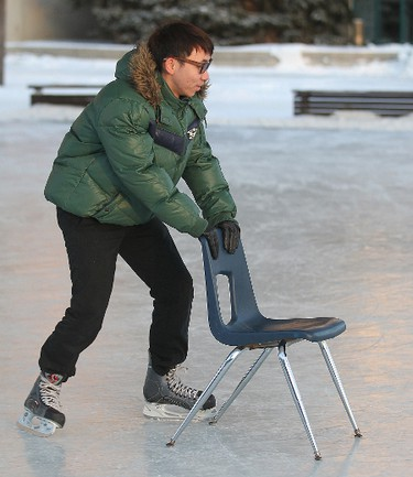 Dreamco Li from Gongdong, China braves the cold at the Forks while skating for the first time in Winnipeg Thursday January 19, 2012. BRIAN DONOGH/WINNIPEG SUN/QMI AGENCY