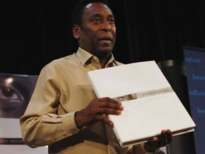 """Brazil's soccer legend Pele was quoted in a French newspaper that """"now is a good time to clean up FIFA, from top to bottom."""" (REUTERS/Paulo Whitaker)"""
