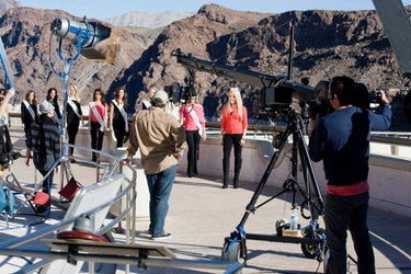 Miss America contestants pre-tape part of the televised pageant`s opening segment at the Hoover Dam, near Las Vegas, Nev. Former Miss America 2011 Teresa Scanlan is in the foreground. All are wearing Canadian-made clothing from Joseph Ribkoff, the official designer of the pageant. (BRUCE VARTAN BOYAJIAN)
