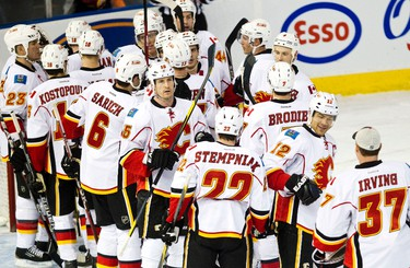 The Calgary Flames celebrate their win during the third period of the Edmonton Oilers NHL hockey game against the Calgary Flames at Rexall Place in Edmonton on Saturday, January 21, 2012. The Flames won by a score of 6-2. CODIE MCLACHLAN/EDMONTON SUN QMI AGENCY