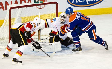 Edmonton's Darcy Hordichuk can't get past Calgary's Miikka Kiprusoff during the third period of the Edmonton Oilers NHL hockey game against the Calgary Flames at Rexall Place in Edmonton on Saturday, January 21, 2012. The Flames won by a score of 6-2. CODIE MCLACHLAN/EDMONTON SUN QMI AGENCY