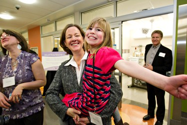 Charlotte Keiller, 9, goofs around with Premier Alison Redford as her mother, Tiffany Keiller, looks on during the launch of the newly completed pediatrics emergency department at the Stollery children's hospital in Edmonton, Alberta on Monday, January 23, 2012. Keiller, who was born with a hole in her heart, has had extensive experience at the Stollery. The premier was kicking off her cabinet tour in Edmonton. AMBER BRACKEN/EDMONTON SUN/QMI AGENCY