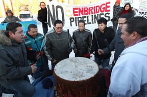 Traditional drummers from the Enoch Cree Nation take part in a protest outside the start of the Enbridge Northern Gateway Project review hearings in Edmonton on Jan.  24, 2012.  (DAVID BLOOM/QMI AGENCY)