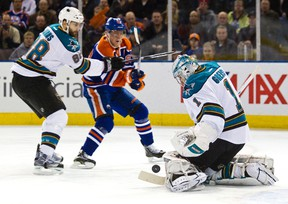 Ales Hemsky follows the puck as Sharks goalie Thomas Greiss makes the stop during first-period action at Rexall Place Monday. (Codie McLachlan, Edmonton Sun)