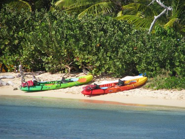 Colourful boats wait to be rented a stretch of beach at Saint-Martin's Pinel Island. ROBIN ROBINSON/QMI Agency