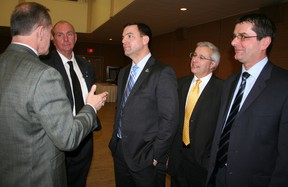 Ontario Progressive Conservative leader Tim Hudak, centre, listens as Northern College president Fred Gibbons, left, makes a point following Hudak's speech at a Timmins Chamber of Commerce luncheon at the Dante Club Wednesday. (RON GRECH/QMI AGENCY)