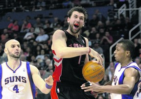 Raptors' Andrea Bargnani gets fouled by Suns point guard Sebastian Telfair (right) during Toronto's Tuesday night win in Phoenix. (REUTERS)