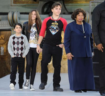 Michael Jackson's children (L-R) Blanket, Paris, Prince and his mother Kathleen attend a ceremony where the singer is immortalized by placing hand and foot imprints in cement in the courtyard of Hollywood's Grauman's Chinese Theatre in Los Angeles on January 26, 2012. REUTERS/Phil McCarten (UNITED STATES - Tags: ENTERTAINMENT)
