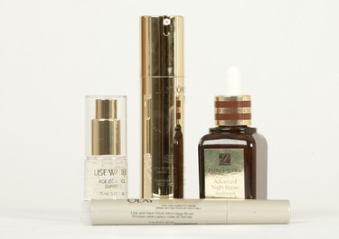 Lise Watier Age Control Supreme Crystal Day Elixir($45, 15ml), Lancôme Absolue Precious Cells Advanced Regenerating Concentrate ($175, 50ml),  Estee Lauder Advanced Night Repair Synchronized Recovery Complex($94, 50ml) and Olay Total Effects 7-in-1Anti-Aging Eye Cream with brush applicator ($29.99,6 ml). (CRAIG GLOVER/QMI AGENCY)