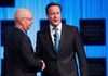 Britain's Prime Minister David Cameron (R) shakes hands with Klaus Schwab, Founder and Executive Chairman, World Economic Forum, during a session at the World Economic Forum (WEF) in Davos, January 26, 2012. (REUTERS/Arnd Wiegmann)