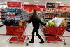 """A woman pulls shopping carts through the aisle of a Target store on the shopping day dubbed """"Black Friday"""" in Torrington, Conn. Nov. 25, 2011. REUTERS/Jessica Rinaldi"""