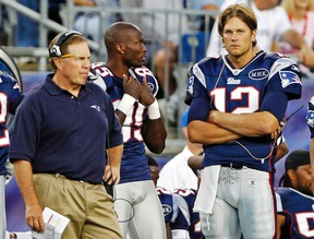New England Patriots quarterback Tom Brady (right), wide receiver Chad Ochocinco and head coach Bill Belichick  look on during a preseason game against Jacksonville. The season didn't turn out the way Ochocinco intended, though he is playing in the Super Bowl. (REUTERS)