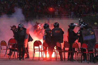 Police react as chaos erupts at a soccer stadium in Port Said city, Egypt, February 1, 2012. (REUTERS/Stringer)