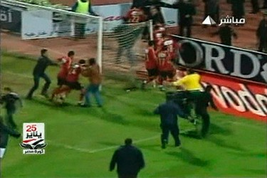 In this still image taken from video, soccer fans invade the pitch chasing Al Ahli players during a soccer match between Al Ahli and al-Masry in Port Said February 1, 2012. (REUTERS/Egypt Tv via Reuters Tv)
