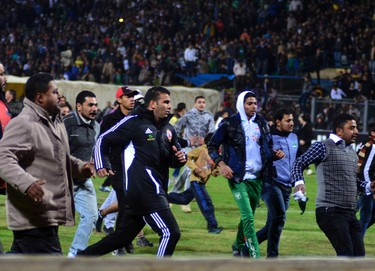 Football fans try to leave the stadium as chaos erupts at a soccer stadium in Port Said city, Egypt, February, 1, 2012. (REUTERS/Stringer)