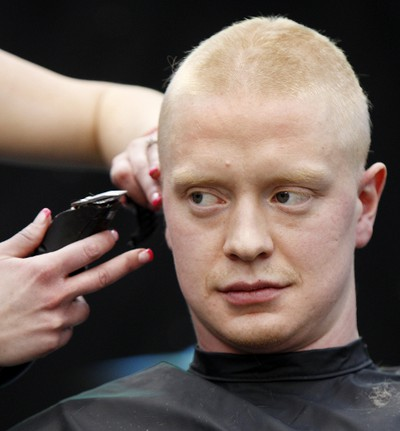 Edmonton Oilers rookie Lennart Petrell looks serious after having his head shaved during the 10th annual Hair Massacure at the ice rink at West Edmonton Mall on Friday February 3, 2012. Over 1500 people had their heads shaved helping to raise 100's of thousands of dollars. All funds raised at the 10th annual Hair Massacure will support the Stollery Children's Hospital Foundation, Make-a-Wish Northern Alberta and Ronald McDonald House Northern Alberta. Three Oilers rookies Ryan Nugent-Hopkins, Anton Lander and Lennart Petrell had their heads shaved. TOM BRAID/EDMONTON SUN  QMI AGENCY