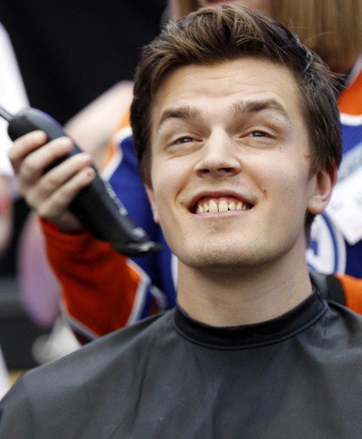 Edmonton Oilers rookie Anton Lander smiles just before having his head shaved during the 10th annual Hair Massacure at the ice rink at West Edmonton Mall on Friday February 3, 2012. Over 1500 people had their heads shaved helping to raise 100's of thousands of dollars. All funds raised at the 10th annual Hair Massacure will support the Stollery Children's Hospital Foundation, Make-a-Wish Northern Alberta and Ronald McDonald House Northern Alberta. Three Oilers rookies Nugent-Hopkins  Anton Lander and Lennart Petrell had their heads shaved. TOM BRAID/EDMONTON SUN  QMI AGENCY
