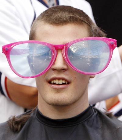 Edmonton Oilers rookie Anton Lander has some fun with over-sized glasses after his head was shaved during the 10th annual Hair Massacure at the ice rink at West Edmonton Mall on Friday February 3, 2012. Over 1500 people had their heads shaved helping to raise 100's of thousands of dollars. All funds raised at the 10th annual Hair Massacure will support the Stollery Children's Hospital Foundation, Make-a-Wish Northern Alberta and Ronald McDonald House Northern Alberta. Three Oilers rookies Nugent-Hopkins  Anton Lander and Lennart Petrell had their heads shaved. TOM BRAID/EDMONTON SUN  QMI AGENCY