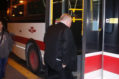 Rob Ford boards a bus during his late-night transit ride to speak with commuters Feb. 8, 2012. (Joe Warmington/Toronto Sun)