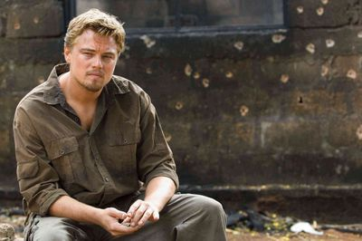 """<b>Leonardo DiCaprio and orphans in Mozambique</b><br>When he filmed Blood Diamond in Mozambique, Leonardo DiCaprio worked with 24 orphaned children. Volunteers with African Impact can do the same. They will spend their mornings at a local preschool and most afternoons involved in a number of other exciting community initiatives including language lessons, orphan care, rural home building and sports coaching. Volunteers will make friends for life as they explore this beautiful location on the shores of the Indian Ocean. Click <A HREF=""""http://govoluntouring.com/mozambique-pre-school-teaching-community-project"""" TARGET=""""newwindow"""">here</a> to learn more about this trip. (Jaap Buitendijk/Warner Bros. Pictures)"""