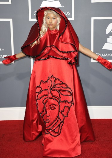 Star: Nicki Minaj.  Grade: F   Sure, there's such a thing as artful fashion, but a line is definitely drawn when something becomes unpleasant to look at - we have Minaj's Versace cape and gown to thank for making that distinction. (Joe KLAMAR/AFP PHOTO)