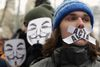 Anti-online censorship protesters wear Guy Fawkes masks in Riga, Feb. 13, 2012.  REUTERS/Ints Kalnins