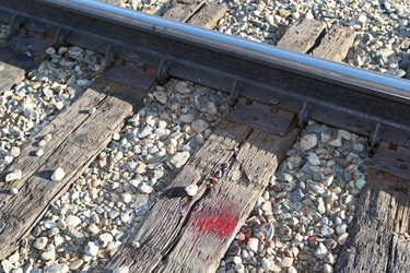 Blood is still visible at the spot where Daniel Michael McPherson, 19,was struck and killed by a train near 50 Street and Rollyview Road in Leduc Alberta, Tuesday Feb. 14, 2012. RCMP believe McPherson was walking south along the tracks wearing his headphones Feb. 13, 2012 when he was struck by a southbound train.  DAVID BLOOM EDMONTON SUN  QMI AGENCY