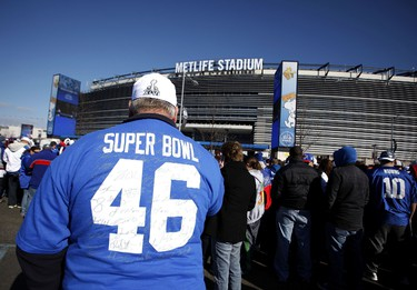 John Dock waits in line to attend a rally to celebrate the New York Giants' Super Bowl victory at MetLife Stadium on February 7, 2012 in East Rutherford, New Jersey. The Giants defeated the New England Patriots 21-17 in Super Bowl XLVI at Lucas Oil Stadium on February 5, 2012 in Indianapolis, Indiana. (Jeff Zelevansky/Getty Images/AFP)