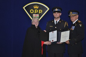 Orillia OPP Const. Elliott Duhamel accepts a St. John Ambulance award for his efforts to save the life of William Hart, who stopped breathing while in police custody July 1, 2009. (QMI Agency)