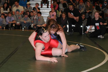 Jenna Brace of Grande Prairie (Zone 8) gets on top of Gabby St. Amoure (red), who is also from Grande Prairie but wrestling for Zone 3 during the Alberta Winter Games in Spruce Grove, Feb. 10, 2012            TERRY FARRELL/DAILY HERALD-TRIBUNE/QMI AGENCY