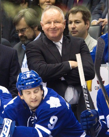 Toronto Maple Leafs head coach Randy Carlyle stands behind the bench. (REUTERS/Fred Thornhill)