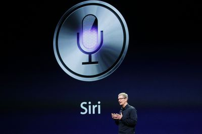 CEO Tim Cook talks about Siri during an Apple event in San Francisco March 7, 2012.  REUTERS/Robert Galbraith