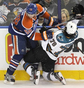 Oilers defenceman Jeff Petry collides with Sharks forward Benn Ferriero at Rexall Place in Edmonton, Alta., March 12, 2012. (DAN RIEDLHUBER/Reuters)