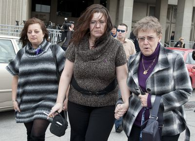 Tori Stafford's mother Tara McDonald, left, leaves the London, Ont. courthouse holding hands with her mother, Linda Winters, right, a friend, left, and boyfriend James Goris, walking behind, after testifying in Michael Rafferty's trial on March 7, 2012. (CRAIG GLOVER/QMI Agency)