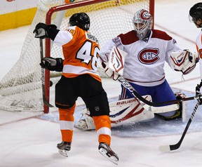 Philadelphia Flyers winger Danny Briere scores a goal past Montreal's goalie Peter Budaj during the second period of their game in Philadelphia, March 24, 2012. (REUTERS/Tim Shaffer)