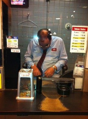 Passenger Earl Campbell snapped this photo Wednesday night of a TTC fare collector apparently napping on the job at the Summerhill station.
