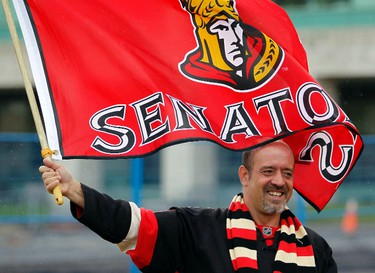 April 10, 2012 - Fan, Marc Rouleau, shows his  team support during a rally at City Hall for the Ottawa Senators' playoff run Tuesday, April 10, 2012. (DARREN BROWN/QMI AGENCY)
