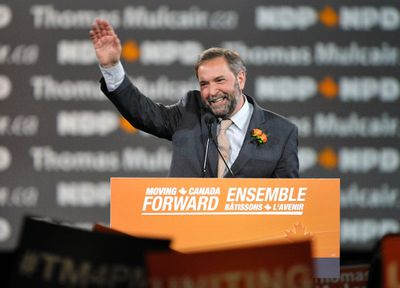 Leadership candidate Thomas Mulcair waves while speaking to delegates during the NDP Leadership Convention in Toronto March 23, 2012. REUTERS/Mike Cassese
