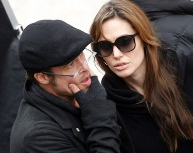 Actors Brad Pitt (L) and Angelina Jolie are seen on the set of In the Land of Blood and Honey November 8, 2010. (REUTERS/Laszlo Balogh)