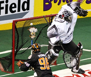Edmonton's Aaron Bold can't stop Buffalo's James Purves during the Edmonton Rush's NLL lacrosse game against the Buffalo Bandits at Rexall Place in Edmonton on Saturday, April 14, 2012. CODIE MCLACHLAN/EDMONTON SUN QMI AGENCY